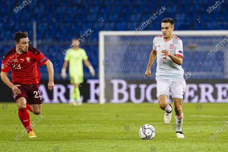 Sergio Reguil-n of Spain (R) is chased by Xherdan Shaqiri of Switzerland (L)