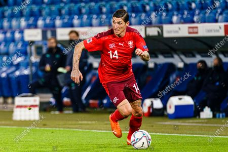 Stock Picture of Steven Zuber of Switzerland runs with the ball
