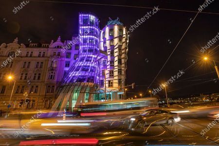 Stock Photo of Purple lights illuminate the Dancing House designed by Frank Gehry on the occasion of World Prematurity Day in Prague, Czech Republic, 16 November 2020. World Prematurity Day is observed annually on 17 November since 2011 to raise awareness of the consequences and health risks related to preterm child delivery.