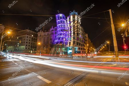 Purple lights illuminate the Dancing House designed by Frank Gehry on the occasion of World Prematurity Day in Prague, Czech Republic, 16 November 2020. World Prematurity Day is observed annually on 17 November since 2011 to raise awareness of the consequences and health risks related to preterm child delivery.