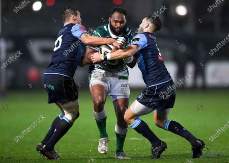 Cardiff Blues vs Benetton Rugby. Ratuva Tavuyara of Benetton is tackled by Jarrod Evans and Jamie Hill of Cardiff Blues