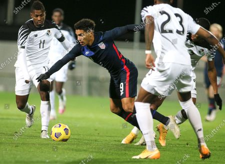 United States' Nicholas Gioacchini battles for the ball with Panama's Armando Cooper, left, and Michael Murillo, right, during the international friendly soccer match between the USA and Panama at the SC Wiener Neustadt stadium in Wiener Neustadt, Austria