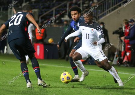 Stock Photo of Panama's Armando Cooper, right, looks to take the ball past United States' Reggie Cannon, left, during the international friendly soccer match between the USA and Panama at the SC Wiener Neustadt stadium in Wiener Neustadt, Austria