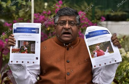 Union Minister, Ravi Shankar Prasad showing clippings of statement of PDP leader Mehbooba Mufti and NC leader Farooq Abdullah of Kashmir during a press conference at his residence on November 16, 2020 in New Delhi, India.