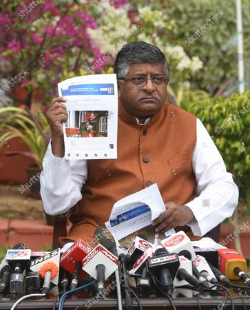 Stock Picture of Union Minister Ravi Shankar Prasad holds up news clippings of statements by PDP leader Mehbooba Mufti, during a press conference at his residence on November 16, 2020 in New Delhi, India.