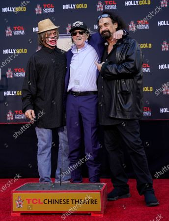 Stock Photo of Actor Michael Madsen, center, is flanked by longtime friends David Fralich, left, and Myke Michael after a hand and footprint ceremony for Madsen at the TCL Chinese Theatre, in Los Angeles