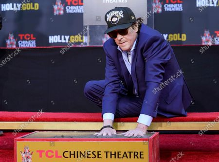 Stock Image of Actor Michael Madsen puts his hands in cement during a ceremony for him at the TCL Chinese Theatre, in Los Angeles