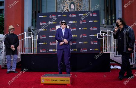 Stock Picture of Actor Michael Madsen, center, is flanked by longtime friends David Fralich, left, and Myke Michael during a hand and footprint ceremony for Madsen at the TCL Chinese Theatre, in Los Angeles