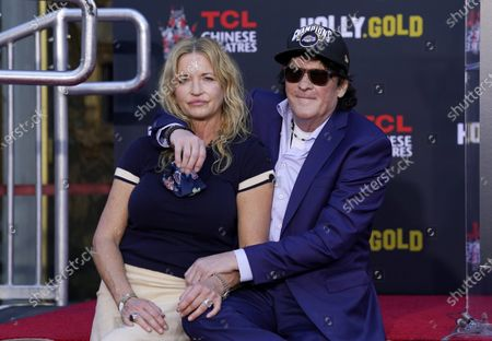 Actor Michael Madsen, right, poses with his wife DeAnna Madsen after a hand and footprint ceremony for him at the TCL Chinese Theatre, in Los Angeles