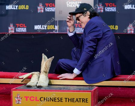 Actor Michael Madsen waits as his boots get imprinted in cement during a ceremony for him at the TCL Chinese Theatre, in Los Angeles