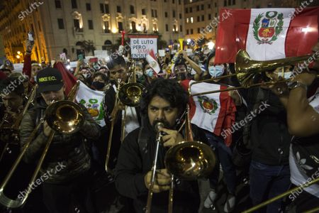 Musicians perform Peru's national anthem in San Martin square after Peru's new interim President Francisco Sagasti was designated by Congress to lead the nation, in Lima, Peru, . Lawmakers chose Sagasti to become the nation's third president in the span of a week after they ousted Martin Vizcarra and the following protests forced his successor Manuel Merino to resign