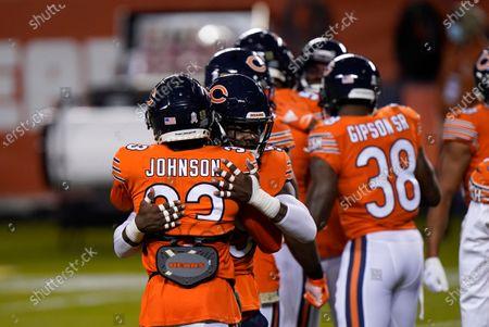 Chicago Bears cornerback Jaylon Johnson (33) and linebacker Danny Trevathan hug before the start of an NFL football game against the Minnesota Vikings, in Chicago