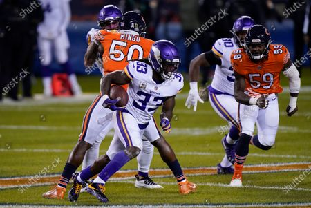 Minnesota Vikings running back Dalvin Cook (33) runs with the ball as Chicago Bears linebacker Danny Trevathan (59) defends during the first half of an NFL football game, in Chicago