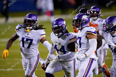 Stock Picture of Minnesota Vikings safety Josh Metellus (44) celebrates with teammates after recovering a fumbled punt return by Chicago Bears' Dwayne Harris during the second half of an NFL football game, in Chicago