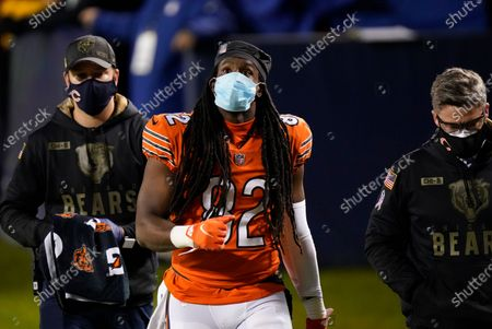 Chicago Bears wide receiver Dwayne Harris walks off the field after getting injured during the second half of an NFL football game against the Minnesota Vikings, in Chicago