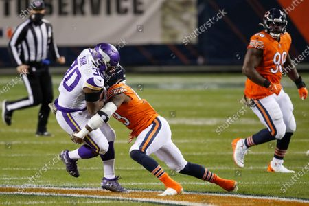 Chicago Bears inside linebacker Danny Trevathan (59) tackles Minnesota Vikings fullback C.J. Ham (30) during the first half of an NFL football game, in Chicago