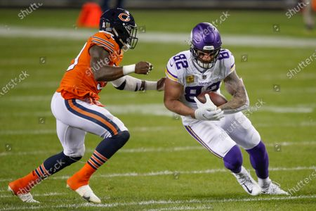 Minnesota Vikings tight end Kyle Rudolph (82) runs with the ball against Chicago Bears inside linebacker Danny Trevathan (59) during the first half of an NFL football game, in Chicago