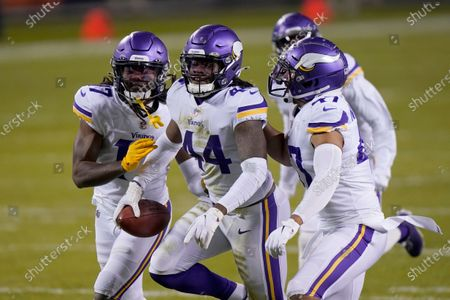 Stock Photo of Minnesota Vikings safety Josh Metellus (44) celebrates with teammates after recovering a fumbled punt return by Chicago Bears' Dwayne Harris during the second half of an NFL football game, in Chicago