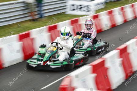 Autodromo Nazionale di Monza, Italy. Thursday 31 August 2017. Sergio Perez, Force India, races football player Michel Salgado in a kart. World Copyright: Sam Bloxham/LAT Images