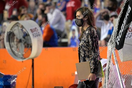 Stock Photo of Sideline reporter Allison Williams watches from the field during the first half of an NCAA college football game between Florida and Arkansas, in Gainesville, Fla