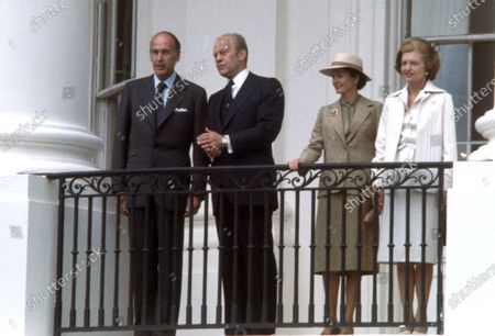 President Valéry Giscard d'Estaing of France, left, look at the crowd to the crowd as United States President Gerald R. Ford, left center, looks on as he is welcomed to the White House in Washington, DC for a State Visit. Anne-Aymone Giscard d'Estaing, right center, and first lady Betty Ford, right, are pictured with their husbands.