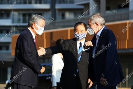 Stock Image of (L to R)   Saburo Kawabuchi,  Toshiaki Endo,   IOCThomas Bach :  IOC President Thomas Bach visits the Olympic Village (Athlete Village)  at the Tokyo 2020 Olympic Games in Tokyo, Japan.