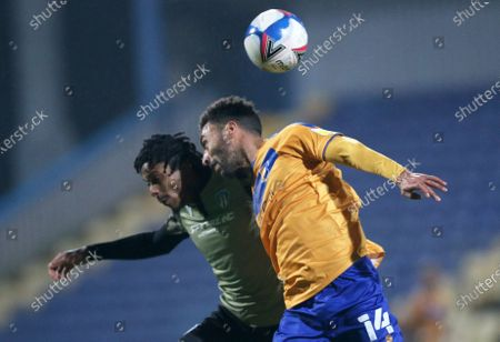 Mansfield Town's James Perch battles with Colchester United's Jevani Brown