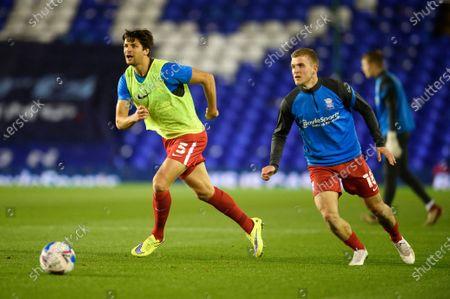George Friend of Birmingham City warms up with Riley McGree of Birmingham City.
