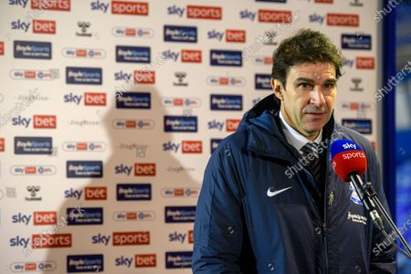 Stock Photo of Aitor Karanka Head Coach of Birmingham City talks to sky sports in front of a skybet branded back drop.