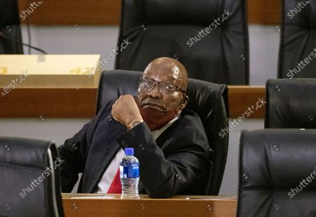 Former South African President Jacob Zuma appears at the hearing for his application for Deputy Chief Justice Raymond Zondo, to recuse himself from the state capture commission inquiry, in Johannesburg, South Africa, . Zuma is appearing before a state commission investigating serious allegations of corruption during his tenure as head of state between 2009 and 2018
