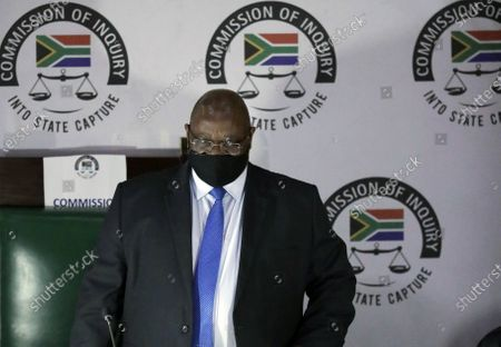 Judge Raymond Zondo, chairman of the Zondo Commission of Inquiry into State Capture, arrives in court, in Johannesburg, . Former President Jacob Zuma is appearing before a state commission investigating serious allegations of corruption during his tenure as head of state between 2009 and 2018