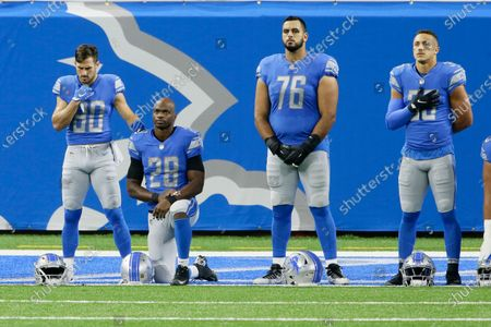 Detroit Lions offensive guard Oday Aboushi (76), stands with wide receiver Danny Amendola (80), running back Adrian Peterson (28) and safety Miles Killebrew (35) during the national anthem before an NFL football game, in Detroit. NFL players have kneeled during the anthem and have made stands to protest social injustice, but none have done it in quite the same way as Aboushi. He wants to use his platform to shed light on what he says is Israel's oppression of the Palestinians and to promote religious harmony as a Muslim with friends of different faiths