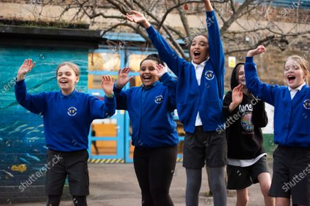 Stock Image of Vodafone Schools.Connected initiative offers free connectivity to schools across the UK by donating 250,000 sim cards loaded with 30GB of data to help bridge the digital divide for at home learning. Former Radio 1 Presenter and ambassador Dev Griffin visits Salsbury Primary School to interview parents, teachers and kids that this programme will support.