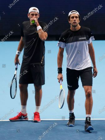Lukasz Kubot of Poland, left, and Marcelo Melo of Brazil, right, chat during their doubles tennis match against Kevin Krawietz of Germany and Andreas Mies of Germany at the ATP World Finals tennis tournament at the O2 arena in London