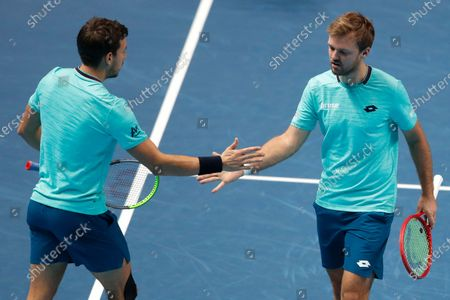 Kevin Krawietz of Germany, right, and Andreas Mies of Germany, left, react during their doubles tennis match against Lukasz Kubot of Poland and Marcelo Melo of Brazil at the ATP World Finals tennis tournament at the O2 arena in London