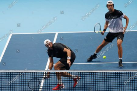 Lukasz Kubot of Poland, front, and Marcelo Melo of Brazil, behind, play a return to Kevin Krawietz of Germany and Andreas Mies of Germany during their doubles tennis match at the ATP World Finals tennis tournament at the O2 arena in London