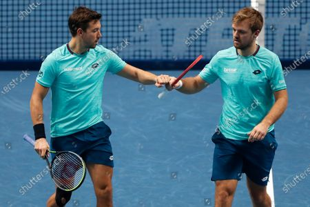 Kevin Krawietz of Germany, right, and Andreas Mies of Germany, left, celebrate during their doubles tennis match against Lukasz Kubot of Poland and Marcelo Melo of Brazil at the ATP World Finals tennis tournament at the O2 arena in London