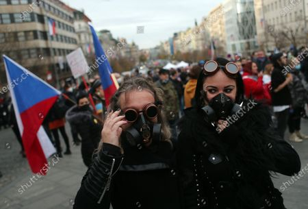 Demonstrators protest against the Czech government's measures in connection with the COVID-19 pandemic caused by the SARS-CoV-2 coronavirus on the 31st anniversary of the Velvet Revolution, in Prague, Czech Republic, 17 November 2020. The Czech Republic has seen a declining trend in COVID-19 positive tested people after authorities imposed measures at the end of October to limit the increase in cases. The Czech Republic celebrates the 31st anniversary of the Velvet Revolution commemorating the events of 17 November 1989, when after the brutal suppression of a student demonstration at Narodni street, the communist leadership soon crumbled and the playwright and human rights activist Vaclav Havel became president shortly thereafter.