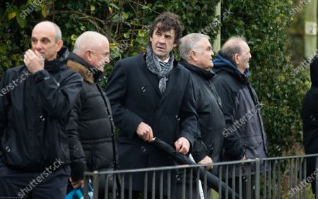 Former Wales National Team Manager Alan Phillips and Wales Team Physiotherapist Mark Davies wait to pay their respects to Wales and British Lions rugby legend JJ Williams on the High Street in Laleston