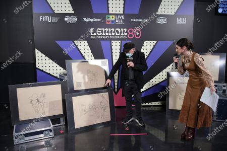 Stock Image of Fabrique Milano Music Week IMAGINE charity campaign Original drawings by John Lennon Lennon museum in London whose lithographs are presented by Rolando Giambelli on the occasion of LENNON80. Lodovica Comello and Rolando Giambelli present works by John Lennon