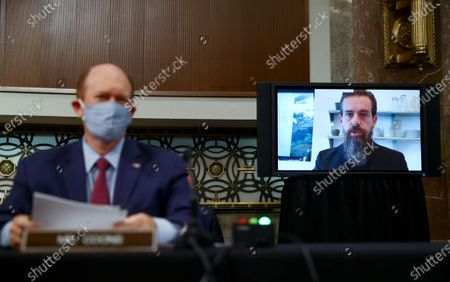 """Twitter CEO Jack Dorsey is seen testifying remotely via videoconference as United States Senator Chris Coons (Democrat of Delaware)listens during a Senate Judiciary Committee hearing titled, """"Breaking the News: Censorship, Suppression, and the 2020 Election,"""" on Facebook and Twitter's content moderation practices, on Capitol Hill in Washington, U.S.,."""