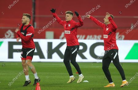 Polish national soccer team players Kamil Grosicki (R), Krzysztof Piatek (C) and Maciej Rybus (L) warms up during his team's training session in Chorzow, Poland, 17 November 2020. Poland will face the Dutch team in their UEFA Nations League soccer match on 18 November 2020 in Chorzow.