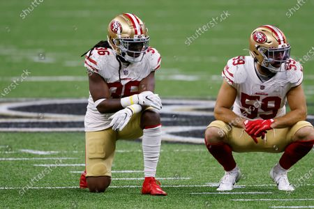 Stock Picture of San Francisco 49ers safety Marcell Harris (36) and linebacker Joe Walker (59) during an NFL football game against the New Orleans Saints, in New Orleans