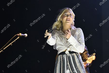 Stock Photo of Maddie Marlow with the band Maddie and Tae performs in concert during the River and Blues Festival