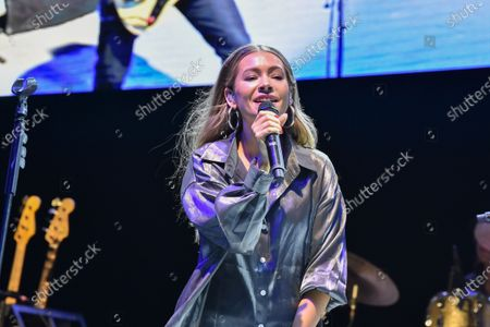 Stock Image of Taylor Dye with the band Maddie and Tae performs in concert during the River and Blues Festival