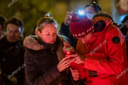 People light candles as they gather at the memorial to students who were attacked by riot police in 1989 on Narodni street, marking the 31st anniversary of the Velvet Revolution in Prague, Czech Republic, 17 November 2020. The Czech Republic celebrates the 31st anniversary of the Velvet Revolution commemorating the events of 17 November 1989, when after the brutal suppression of a student demonstration at Narodni street, the communist leadership soon crumbled and the playwright and human rights activist Vaclav Havel became president shortly thereafter.