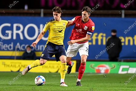 Oxford United midfielder Alex Rodriguez Gorrin(6) battles for possession  with Crewe Alexandra defender Perry Ng (2) during the EFL Sky Bet League 1 match between Oxford United and Crewe Alexandra at the Kassam Stadium, Oxford