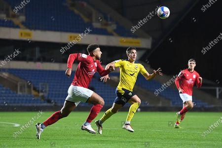 Crewe Alexandra midfielder Daniel Powell (7) and Oxford United midfielder Alex Rodriguez Gorrin(6) chase the ball during the EFL Sky Bet League 1 match between Oxford United and Crewe Alexandra at the Kassam Stadium, Oxford