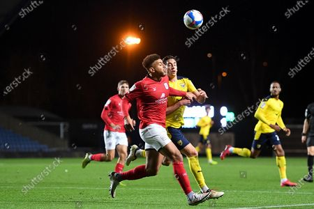 Crewe Alexandra midfielder Daniel Powell (7) head` under pressure from Oxford United midfielder Alex Rodriguez Gorrin (6) during the EFL Sky Bet League 1 match between Oxford United and Crewe Alexandra at the Kassam Stadium, Oxford