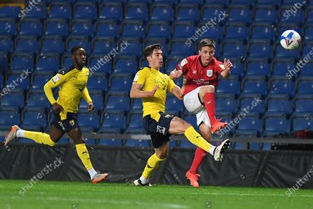 Crewe Alexandra midfielder Tom Lowery (8) gets a pass away under pressure from Oxford United midfielder Alex Rodriguez Gorrin(6) during the EFL Sky Bet League 1 match between Oxford United and Crewe Alexandra at the Kassam Stadium, Oxford